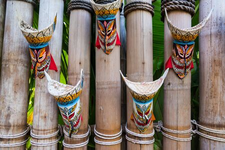 ghost mask: Thai ghost mask, Phi Ta Khon, decorated on the wooden bamboo wall Stock Photo