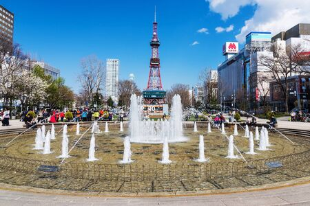 sapporo: SAPPORO, HOKKAIDO, JAPAN - APRIL 24, 2016: Fountain decorated at Odori park in front of Sapporo TV tower.