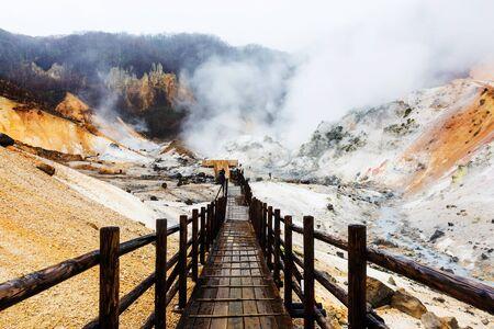 Jigokudani hell valley with wooden walking trail in Noboribetsu, Hokkaido, Japan