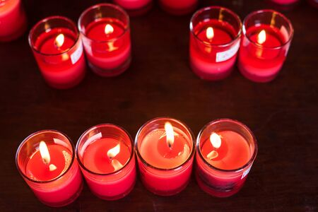 Many burned red candles by top view in Chinese temple to get healthy, wealthy, and luck. Stock Photo