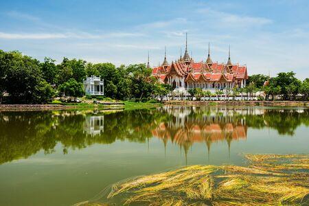 Ubosot Roi Yord with reflection at Wat Phai Rong Wua, Suphanburi, Thailand Stock Photo