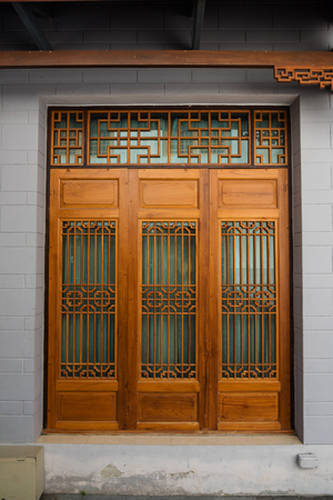 Wooden door by Chinese Style Фото со стока