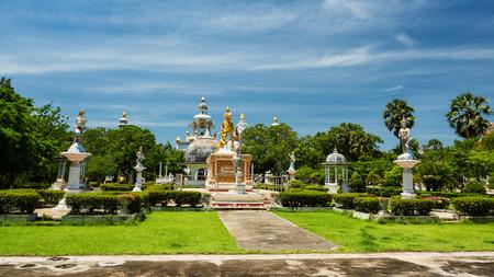 Gold sithata buddha monument at Wat Phai Rong Wua, Suphanburi, Thailand. Foreign language on monument means Sithata in Thai language. Stock Photo