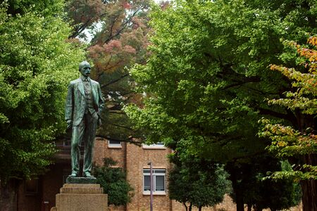 he is public: Josiah Conder statue at University of Tokyo with autumn leaves. He, called father of Japanese modern architecture, is British architect designed numerous public buildings.