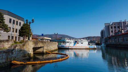 peace pipe: Tourist cruise at Otaru canal against blue sky, Hokkaido, Japan