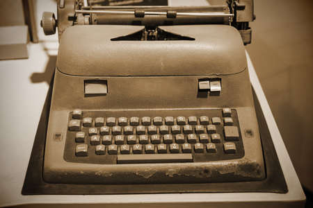 Old Typewriter Machine with sepia color process