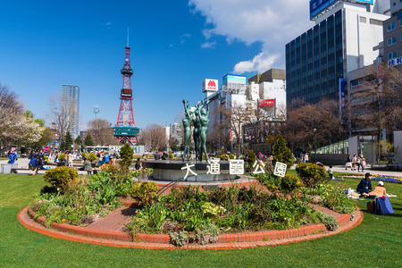odori: SAPPORO, HOKKAIDO, JAPAN - APRIL 24, 2016: Three Women dance statues at Odori park in front of Sapporo TV tower. Editorial