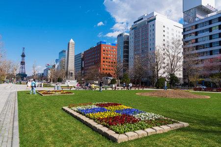 odori: SAPPORO, HOKKAIDO, JAPAN - APRIL 24, 2016: Unidentified people enjoy spring time at Odori park in front of Sapporo TV tower.