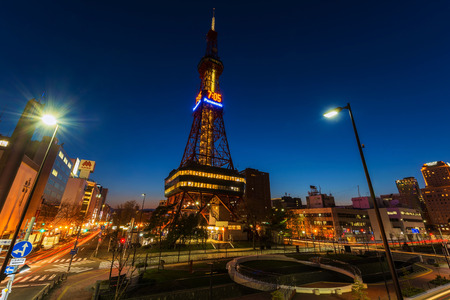 odori: SAPPORO, HOKKAIDO, JAPAN - APRIL 24, 2016: Sapporo TV Tower at dusk in Odori Park. The 147.2 meter high tower has an observation deck open to visitors.