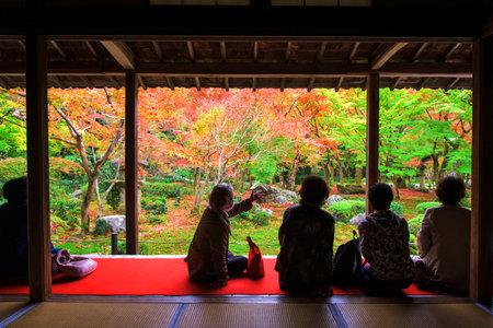 japanese fall foliage: tourists in Enkoji temple enjoy fall foliage color at Japanese garden in Kyoto, Japan.