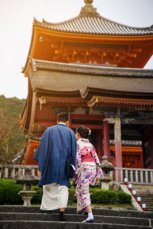 prewedding: Couple with Yukata and Kimono dress taking pre-wedding pictures at Kiyomizu temple, Kyoto, Japan Editorial