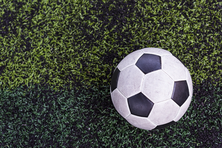 onset: Football on field of artificial green grass Stock Photo