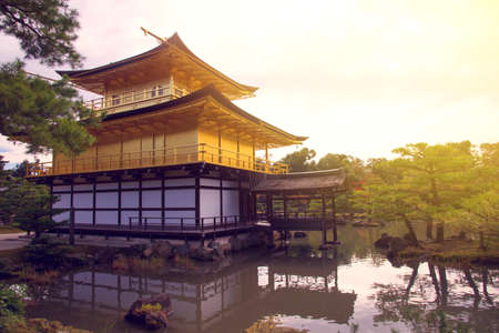 rokuonji: Golden pavillion in Kinkakuji Temple at sunset, Kyoto, Japan Editorial
