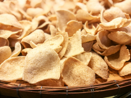 Prawn Shrimp Crackers on wooden container for sale,  thai style snack Stockfoto