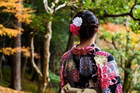beautiful japanese kimono girl enjoy autumn foliage at Kinkakuji temple, Kyoto, Japan