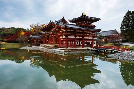 Byodo-ins Phoenix hall with reflection at dusk in Uji, Kyoto, Japan. Here is the most famous Uji landmark jointly with temples of the Jodo-shu and Tendai-shu sects.