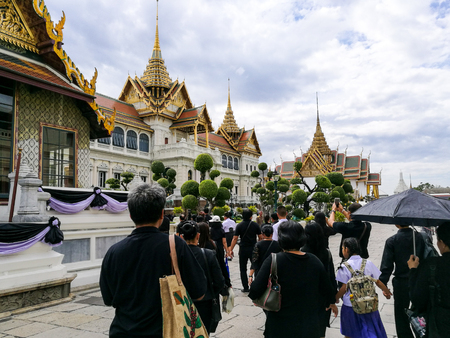 adulyadej: BANGKOK, THAILAND - JANUARY 02, 2017: Unidentified mourn Thai people at Royal Grand Palace to make condolence to the King Bhumibols coffin in the Grand Palace.