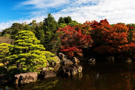 Beautiful Kokoen Garden with autumn foliage colors in Himeji, Japan