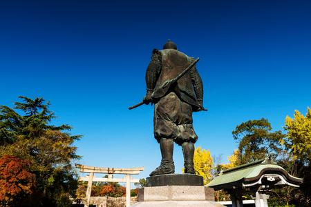 Toyotomi Hideyoshi Statue against blue sky in Hokoku Jinja shrine near Osaka castle, Osaka, Japan Editorial