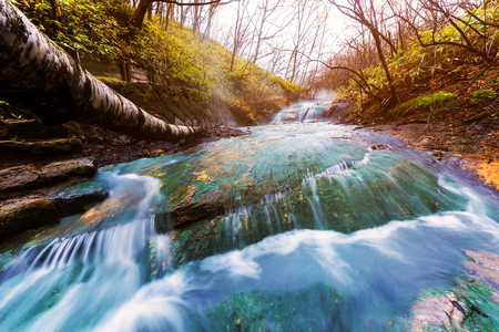 Oyunumagawa Hot spring waterfall with sunset light near Jigokudani hell valley, Noboribetsu, Hokkaido, Japan