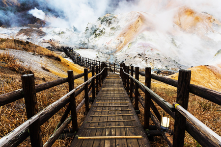 dani: Jigokudani hell valley walking path light up, Noboribetsu, Hokkaido, Japan. Stock Photo