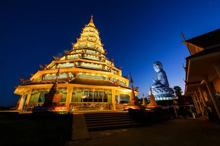 pla: Chinese pagoda and Guan Yin statue at dusk with blue sky in Wat Huay pla kang, Chiang Rai, Thailand. Stock Photo