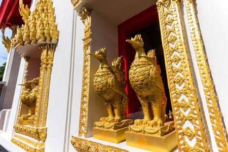 Golden chicken statue on window of Wat Phai Lom in Koh Kred, Nonthaburi, Thailand Stock Photo