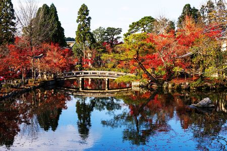 Fall foliage colors with skyline reflection at Eikando Temple in Kyoto, Japan Stock Photo