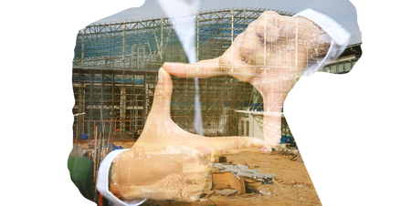 business man thumb and forefinger connect overlay with construction site, Industry concept idea.