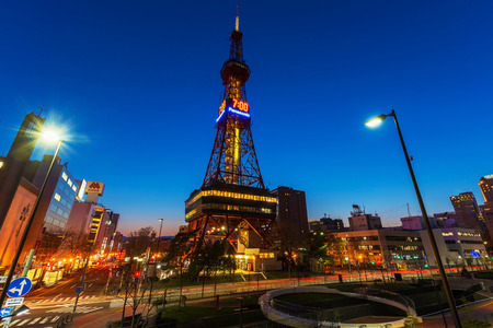 pm: SAPPORO, HOKKAIDO, JAPAN - APRIL 24, 2016: Sapporo TV Tower with twilight sky at 7 pm. in Odori Park. The 147.2 meter high tower has an observation deck open to visitors. Editorial