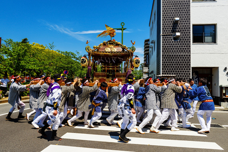 ODAWARA, JAPAN - MAY 05, 2017: Unidentified people parade portable shrines in town to pray prosperity and happiness.This is festival tributed to Hojo Soun, brave warlord in the 16 century. Editorial