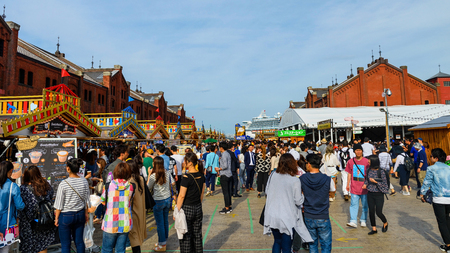 historical events: YOKOHAMA, JAPAN - MAY 6, 2017: Unidentified people buy foods at Yokohama Red brick Warehouse, historical building that is used as a shopping mall and event venues near the pier.