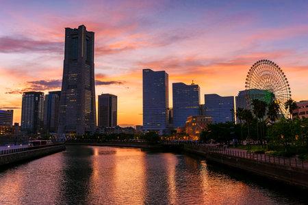 YOKOHAMA, JAPAN - MAY 6, 2017: Yokohama cityscape skyline with twilight sky at dusk in Minato Mirai waterfront district. Here is the most famous landmark in Yokohama.