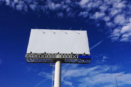 Blank advertisement  billboard against blue sky in Bangkok, Thailand
