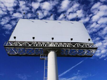 Blank advertisement white billboard against blue sky in Bangkok, Thailand