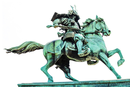 Statue of the great samurai Kusunoki Masashige isolated on white background. It located at the East Garden outside Tokyo Imperial Palace, Japan Stock Photo