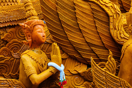 Thai carving wax angel for candle festival. The big candle used in the temple during the raining season