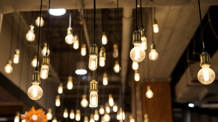 Many light bulbs for interior decoration. Warm yellow color