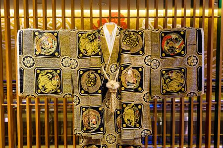 Traditional golden Japanese Yukata costume with paint animals