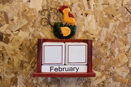 Febrauary month sign with blank date to fulfill, house interior Wooden calendar