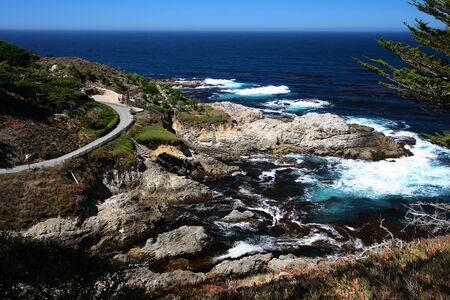 Pacific Ocean bay and curved street near Monterey, California, USA