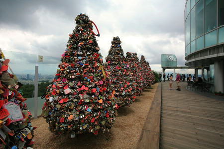 SEOUL, SOUTH KOREA - JUNE 29, 2011: Thousands of love padlocks on trees at N Seoul Tower. This is the symbol that love will be remained forever.