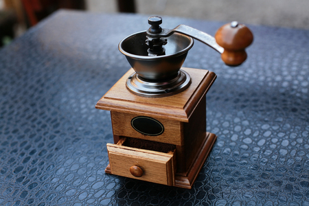 coffee beans are ground in manual coffee grinder