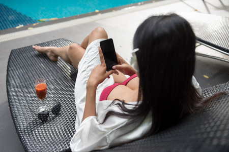 Female relax in a summer at the luxury hotel resort.
