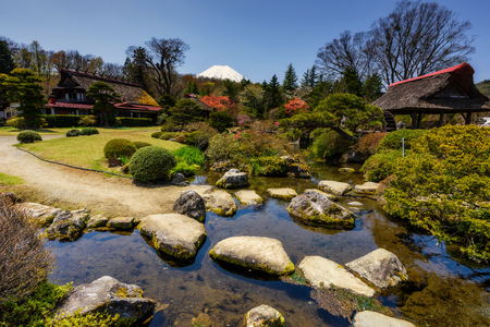 Traditional heritage house with beautiful garden during spring and mountain Fujisan or Fuji view from Oshino Hakkai, Japan