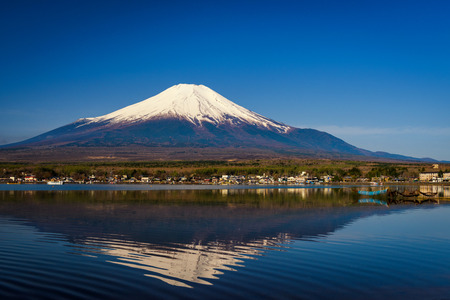 Lake Yamanaka with Mount Fujisan or Fuji, Yamanashi, Japan. Natural scenic landscape with skyline reflection on water. Famous travel destination with copy space for text or background.