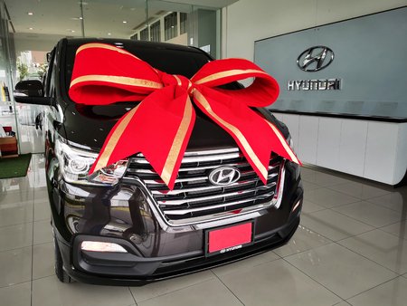 Bangkok, Thailand - May 09, 2019: All new Hyundai H1 2019, Luxury Van, with big red ribbon to be sold and give to owner at car sales gallery showroom.