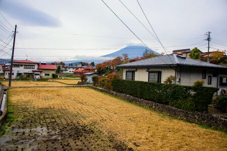 Local Japanese houses with farmland and Mountain Fuji or Fujisan in autumn, Shimoyoshida, Yamanashi, Japan. Here is a place to go to Chureito pagoda by walk from train station.