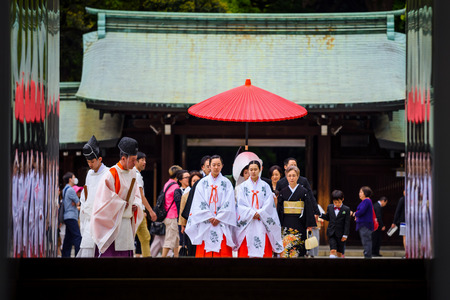 Tokyo, Japan - May 7, 2017: Unidentified Japanese poeple with traditional Ukata and Kimono dress perform celebration of typical Shinto wedding at Meiji Jingu Shrine.