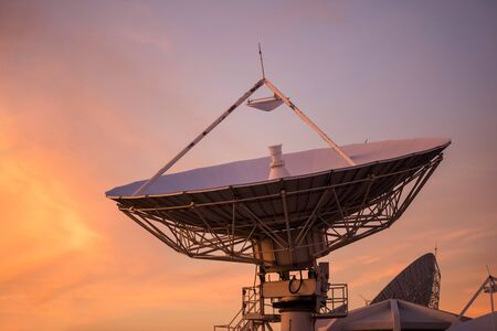 Large satellite dish or antenna with twilight sky at dusk. Telecommunication Technology concept. 版權商用圖片